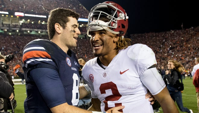 Auburn quarterback Jarrett Stidham (8) and Alabama quarterback Jalen Hurts (2) talk after Auburn beat Alabama in the Iron Bowl in Auburn, Ala. on Saturday November 25, 2017.