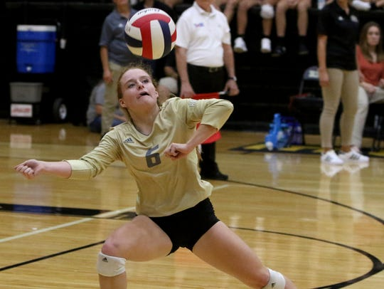 Rider's Logan Browning passes in the match against