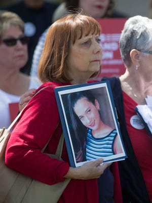 Carol Gaxiola holds a picture of her daughter Jasmine Gaxiola, who was shot and killed when she was 14, during a rally for gun-sense legislation at the state Capitol Building on Thursday, March 31, 2016.