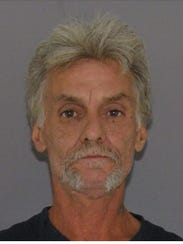James L. Cox, 61, of Elmwood Place, was charged with