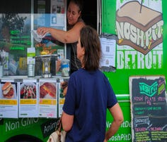 Thousands attend first food truck rally in Meridian Township.
