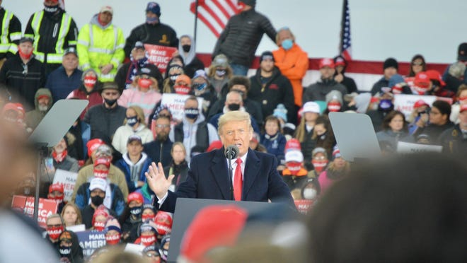 President Donald Trump speaks Saturday, Oct. 17, 2020, at the Muskegon County Airport in Muskegon, Mich., with thousands of his supporters.