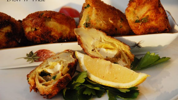 Stuffed artichoke hearts are fried and served as a tangy appetizer.