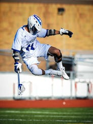 Catholic Central's Peter Thompson leaps for joy after