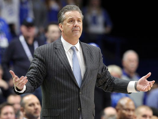 Kentucky head coach John Calipari questions a call during the second half of an NCAA college basketball game against Tennessee, Tuesday, Feb. 6, 2018, in Lexington, Ky. Tennessee won 61-59. (AP Photo/James Crisp)