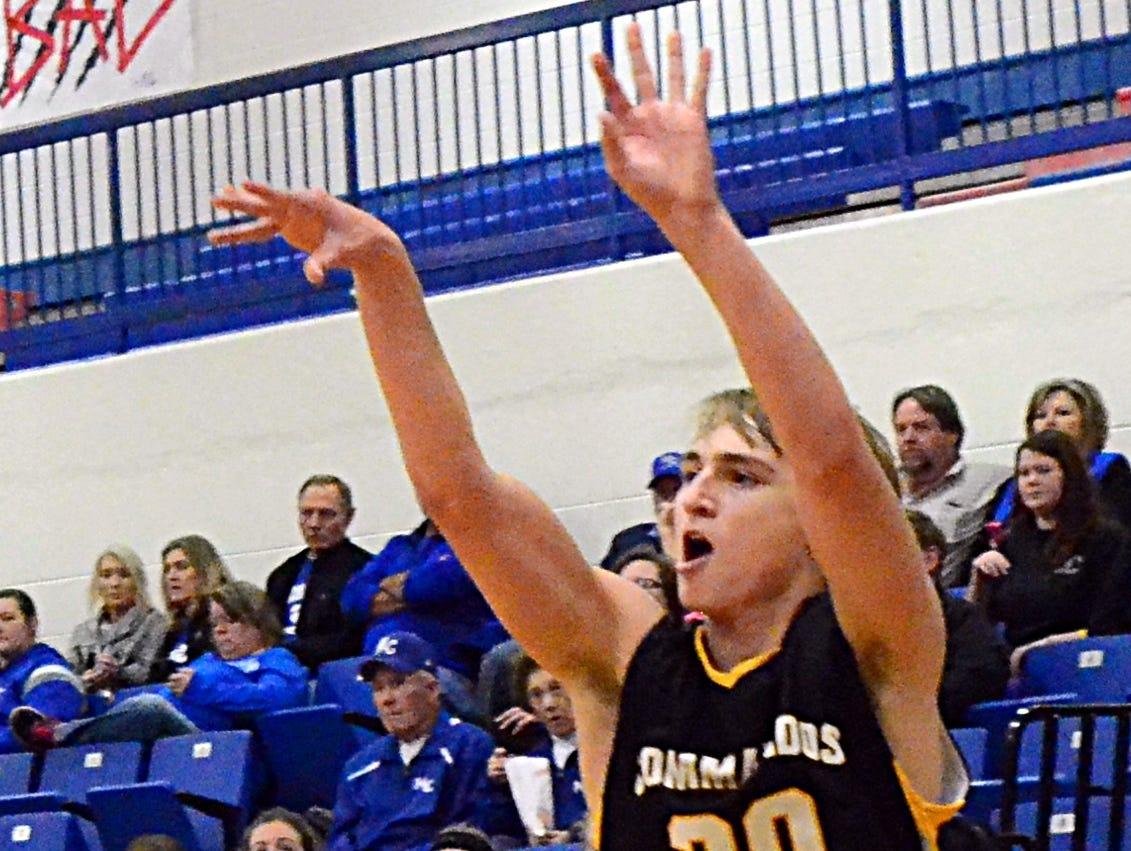 Hendersonville High junior Ryne Loper releases a 3-pointer during third-quarter action. Loper scored four points.