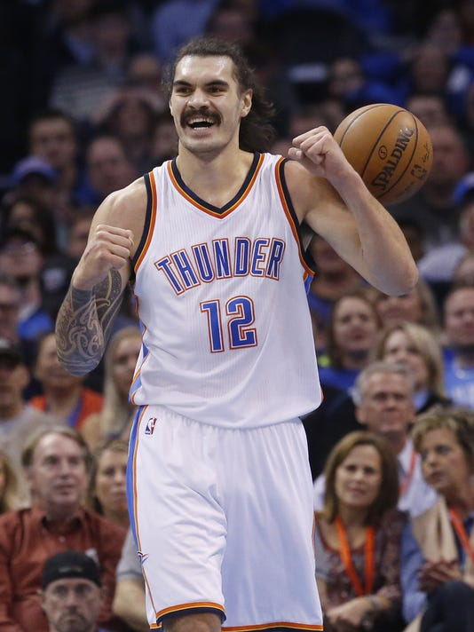 FILE - In this Jan. 4, 2016, file photo, Oklahoma City Thunder center Steven Adams raises his arms during an NBA basketball game against the Sacramento Kings in Oklahoma City. Adam's sister, Valerie Adams, will attempt at the Rio de Janeiro Games to become the first woman to win the same individual track and field event at three consecutive Olympics. (AP Photo/Sue Ogrocki, File)