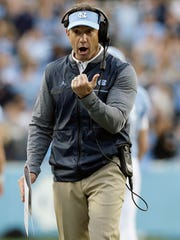 North Carolina coach Larry Fedora reacts during the