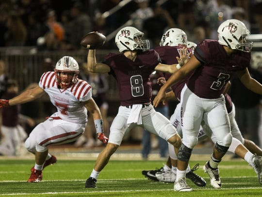 Flour Bluff's Braden Sherron looks to pass the ball against Ray during their District 30-5A interzone playoff game on Friday, Nov. 10, 2017, at Hornets Stadium.