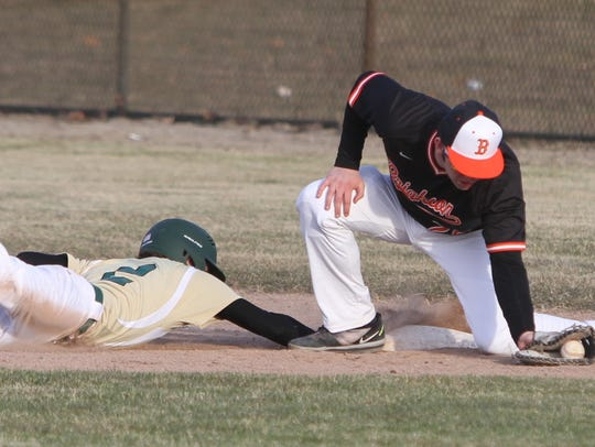 Howell's Johnny Shields dives back into first base