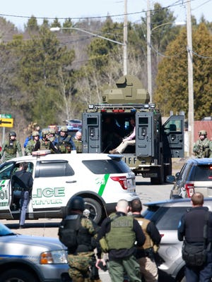 Numerous law enforcement vehicles and SWAT teams respond to shooter Wednesday at an apartment complex on the corner of Aspen Street and Ross Avenue in Weston. A police officer and at least two others were shot.