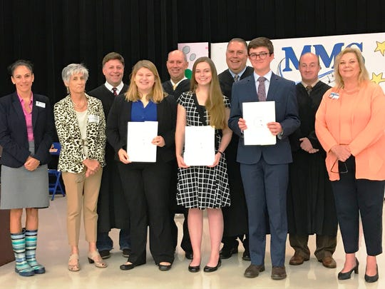 Charlene Lyons, left, YMCA/Youth in Government; Kate Boland, CCV chair; Judge Alan Forst; second-place winner Tabitha Bean; Judge Mark Klingensmith; third-place winner Rebecca Cameron; Judge William Roby; first-place winner Sam Crombie; Judge Darren Steele and Laurie Gaylord, Martin County Superintendent of Schools at the Center for Constitutional Values Constitution Academic Competition.