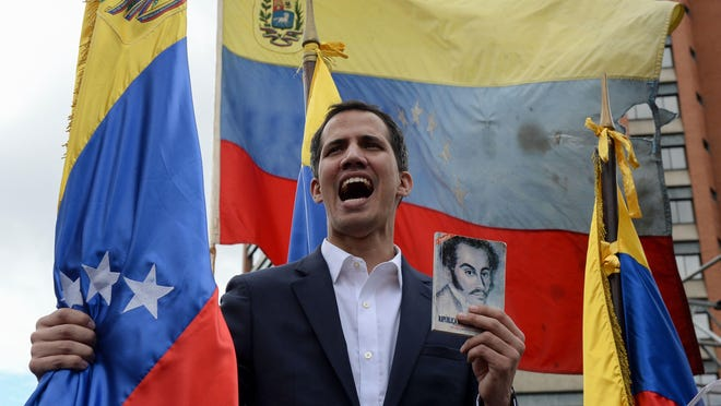 "Venezuela's National Assembly head Juan Guaido declares himself the country's ""acting president"" during a mass opposition rally against leader Nicolas Maduro, on the anniversary of 1958 uprising that overthrew military dictatorship in Caracas on January 23, 2019."