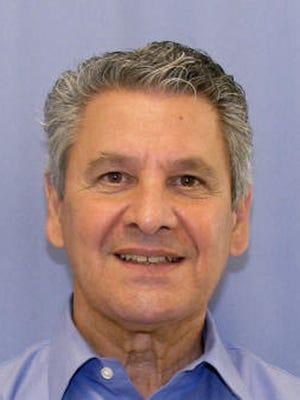 In this undated file photo provided by the Allegheny County District Attorney, Dr. Robert Ferrante is shown.