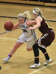 Indianola senior Maddie Glascock drives around Ankeny junior Codee Myers. Class 5-A fifth-ranked Indianola beat Ankeny 52-47 in Indianola on Dec. 15.