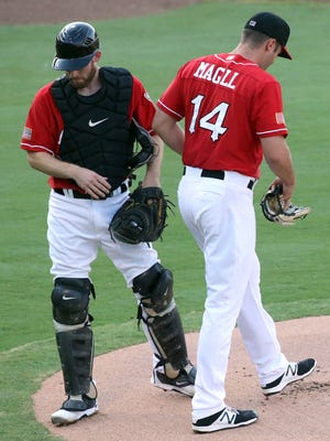 Chihuahuas catcher Rocky Gale talks with pitcher Matt Magill during a break in the action Tuesday night.