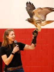 Kayla Jackson shows Jesse, a 20-year-old Red tailed