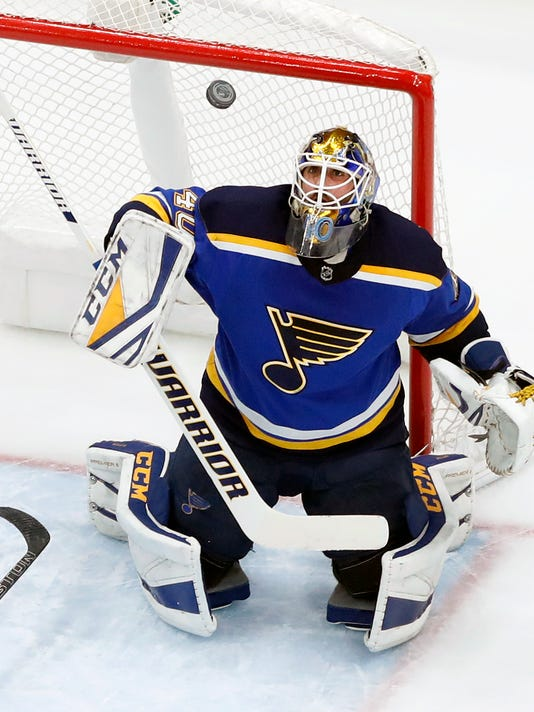 St. Louis Blues goaltender Carter Hutton watches the puck during the second period of the team's NHL hockey game against the Colorado Avalanche on Thursday, Jan. 25, 2018, in St. Louis. (AP Photo/Jeff Roberson)