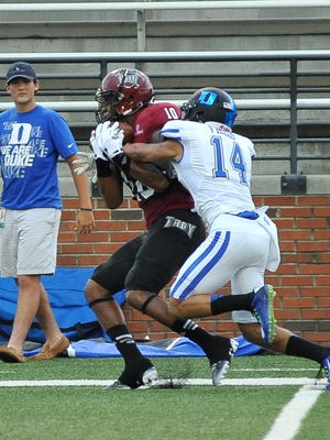 Troy wide receiver B.J. Chitty catches a pass in front of Duke cornerback Bryon Fields on Saturday at Veterans Memorial Stadium.