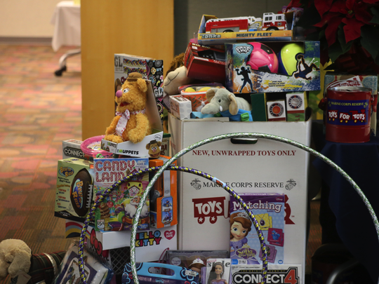 Organize a Toys for Tots drive to give your workplace a feel-good holiday vibe.