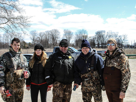Members of Ducks Unlimited-Wayne State University Chapter volunteer with the DNR to clean up St. John's Marsh near the North Channel of the St. Clair River. Adam Smith, chapter president, is far left.