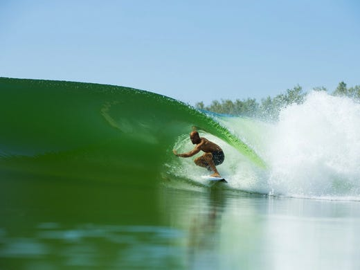 Kelly Slater surfs his man-made wave in a California
