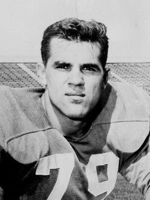In a 1956 file photo, Kentucky tackle Lou Michaels poses for a photo. Michaels, a two-time All-America tackle and a College Football Hall of Famer, has died. He was 80. Michaels' daughter, Michele Grochicki, in Swoyersville, Pa., confirmed his death Tuesday, Jan. 19, 2016. Michaels had pancreatic cancer cancer, she said.