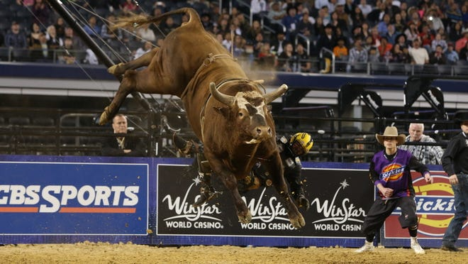 Austin Meier gets bucked from Bushwacker during a Professional Bull-riding event(PBR) in March 2013.