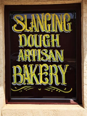 The front window of Slanging Dough, 16 E. 3rd St., on July 23, 2018.