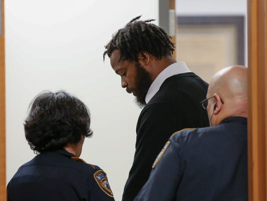 Philadelphia Eagles defensive end Michael Bennett appears in Harris County Civil Court in Houston on Monday, March 26, 2018. Bennett has surrendered to authorities in Houston on a charge that he injured a paraplegic woman as he tried to get onto the field after last year's Super Bowl to celebrate with his brother. (Godofredo A. Vasquez/Houston Chronicle via AP)