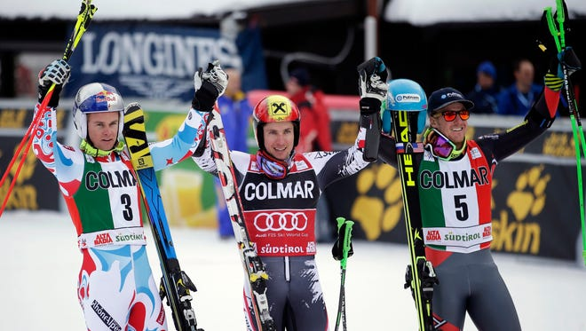 Marcel Hirscher, center, of Austria celebrates with second-placed Alexis Pinturault of France, left, and third placed Ted Ligety, right, of the U.S. after the men's World Cup Giant Slalom skiing race in Alta Badia Dec. 22, 2013.