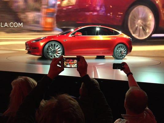 APTOPIX Tesla Lower Priced Car