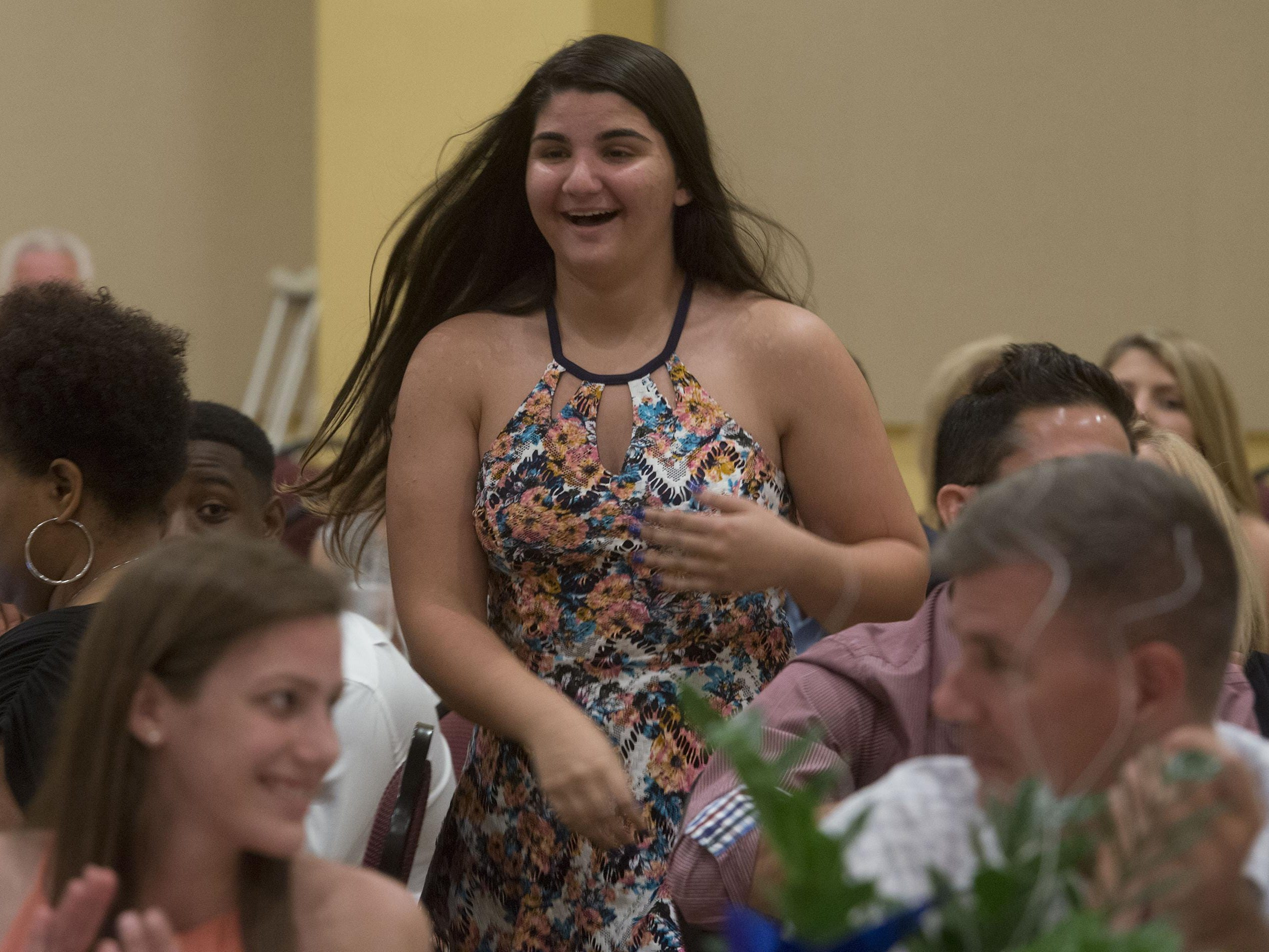 Navarre High School's Olivia Brahms is selected as the female Troy Rafferty Scholarship Award winner during the Pensacola News Journal's All-Sports Banquet Wednesday night.