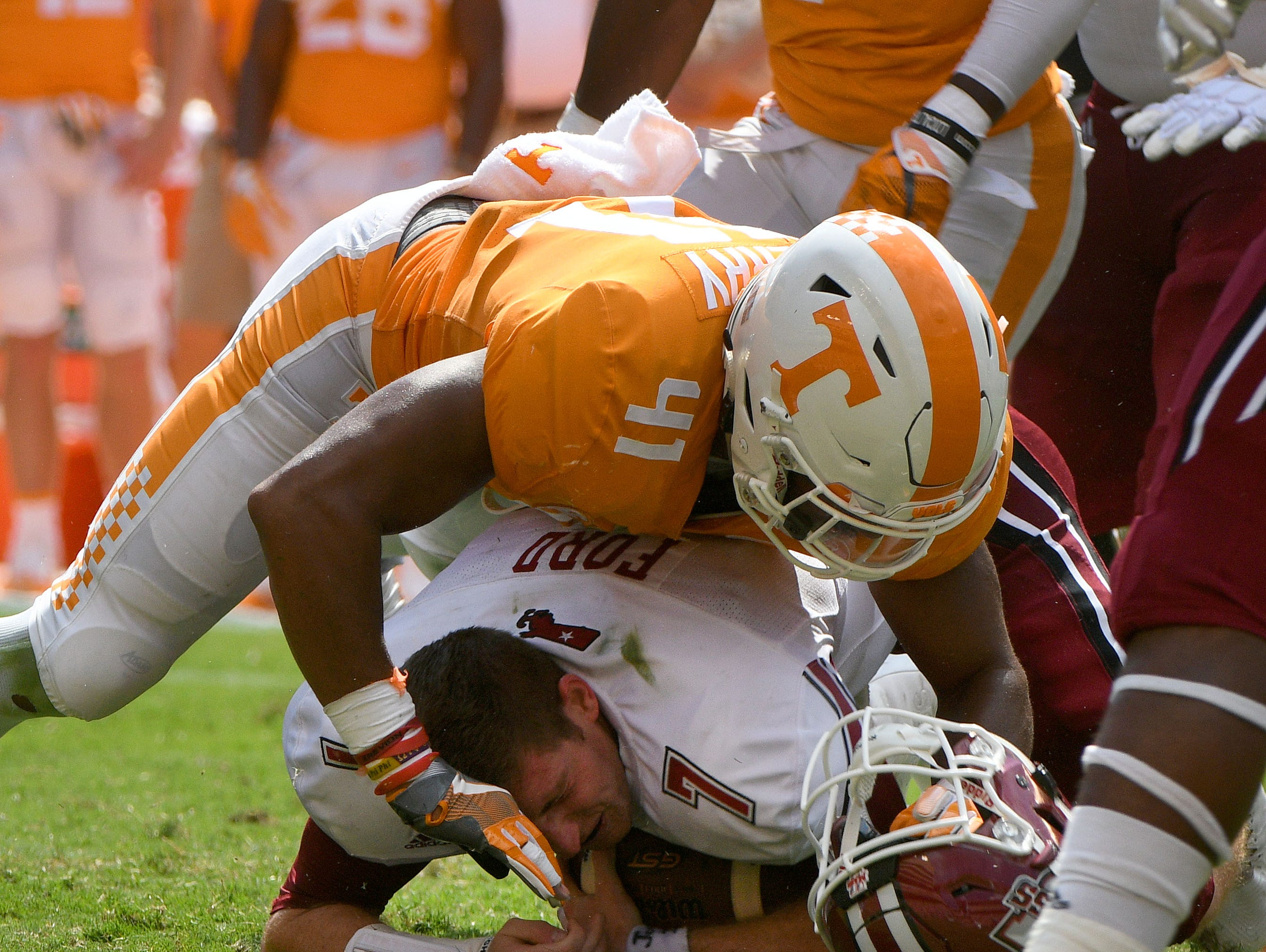 Tennessee linebacker Elliott Berry (41) sacks UMass quarterback Andrew Ford (7) while knocking off his helmet during the second half of their 17-13 win over UMass Minutemen Saturday, Sep. 23, 2017 at Neyland Stadium in Knoxville, Tenn.