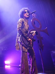 "Prince performs onstage during the ""HitnRun"" tour at"