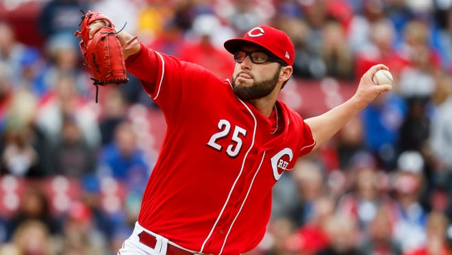 Cincinnati Reds pitcher Cody Reed throws in the first inning of a baseball game against the Chicago Cubs, Saturday, April 22, 2017, in Cincinnati. (AP Photo/John Minchillo)