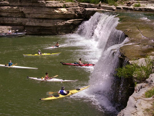 JUNE04/00 WATERFALLS (48957) Photo/Frank Espich :::: An overall view of the LOWER CATARACT FALLS near Cagles Mill Lake within Lieber State Recreation Area in southern Indiana. A group of kayakers and a bass boat gather at the base just playing around enjoying the great Indiana outdoors.  *FOR A GEORGE MCLAREN STORY ON STATE WATERFALLS*