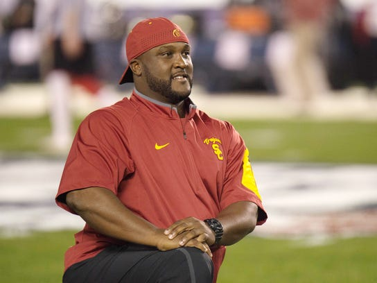 In a 2015 photo provided by the University of Southern California, offensive coordinator Tee Martin waits for a football game. The 38-year-old Martin is a phenomenal recruiter whose career has been on a steady ascent. He joined the Trojans' staff in 2012 as receivers coach, became pass game coordinator in 2014 and was named offensive coordinator at the end of last season. (University of Southern California  via AP)