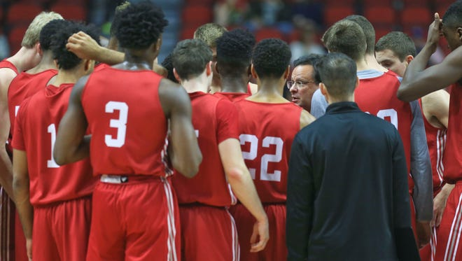 Indiana's Tom Crean talks to his team near the end of practice Wednesday afternoon at Wells Fargo Arena in Des Moines before Thursday's NCAA tournament game.