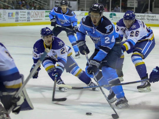 Pensacola's Roger Tagoona (24) skates through the Roanoke Rail Yard Dawgs' defense and heads to their net Sunday afternoon at the Pensacola Bay Center.