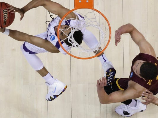 Kansas State guard Kamau Stokes (3) shoots against Loyola-Chicago guard Lucas Williamson (1) during the second half of a regional final NCAA college basketball tournament game, Saturday, March 24, 2018, in Atlanta. Loyola-Chicago won 78-62. (AP Photo/David Goldman)