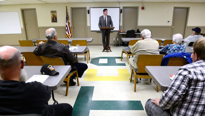 Fremont Municipal Court Judge Dan Brudzinski speaks about the court system at a meeting of the American Patriots Against Government Excess Monday night.