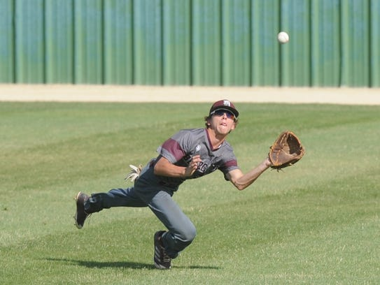 De Leon center fielder Chris Martin makes a diving catch on Layton Reed's fly ball to end the top of the seventh inning in Game 3 of the Bearcats' Region I-2A semifinal series against New Deal on Saturday in Snyder. New Deal won the game 7-1.