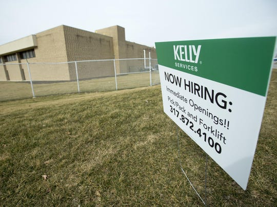This sign, seeking temporary workers, was posted outside the Carrier plant on Indianapolis' west side in February 2016. Carrier had recently announced that it would be closing the plant over the next three years and sending jobs to Mexico.