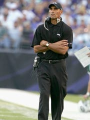 Ex-Jets coach Herm Edwards works a game against the