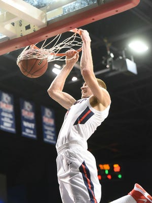 Belmont's Dylan Windler's slam dunk in the first half helped Belmont tie Eastern Kentucky at 22-all.