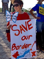 Sylvia Searfoss holds a sign she brought to a protest
