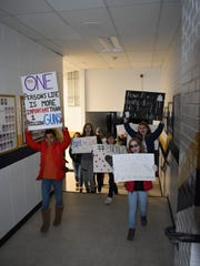 Students from Roberson High School participated in the national school walkouts despite schools being closed due to weather. Students walked the hallways of Roberson to protest gun violence.