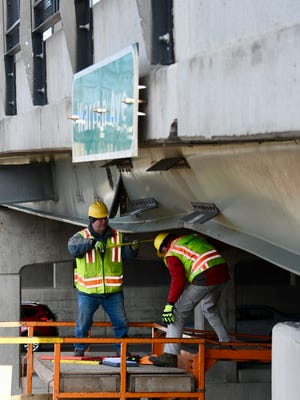 Crews working to repair a beam supporting the Warren overpass that was damaged during a semi-truck crash.