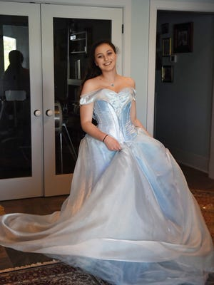 Marissa Maurer models the prom dress that she designed and sewed for the West High prom.